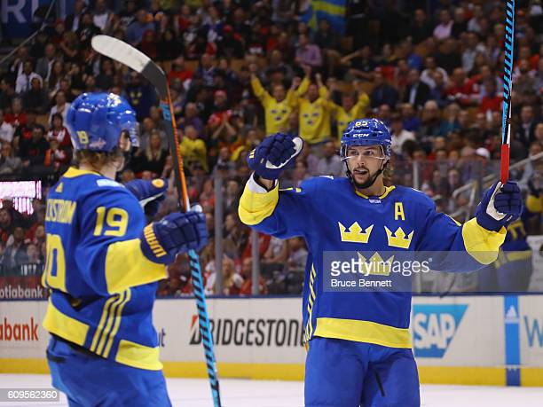 Nicklas Backstrom and Erik Karlsson of Team Sweden celebrate Backstrom's first period goal against Team North America at the World Cup of Hockey...