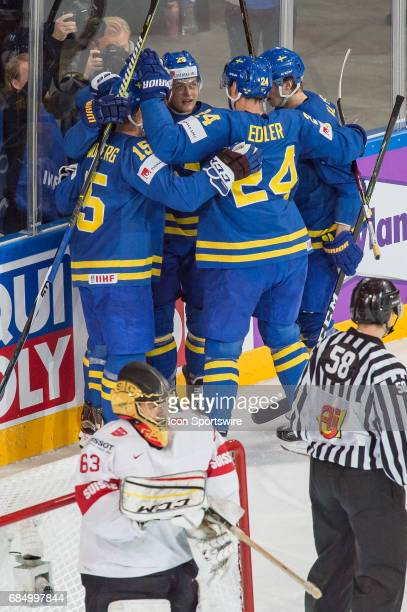 Nicklas Backstrom celebrates his goal with teammates during the Ice Hockey World Championship Quarterfinal between Switzerland and Sweden at...