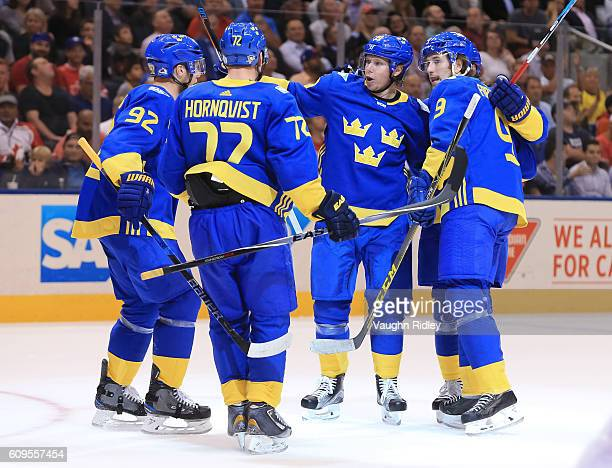 Nicklas Backstrom celebrates with Gabriel Landeskog Patric Hornqvist and Filip Forsberg of Team Sweden after scoring a first period goal Team North...