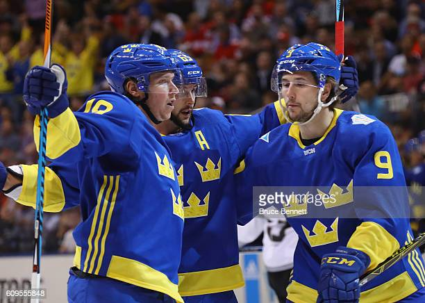 Nicklas Backstrom Erik Karlsson and Filip Forsberg of Team Sweden celebrate Backstrom's first period goal against Team North America at the World Cup...