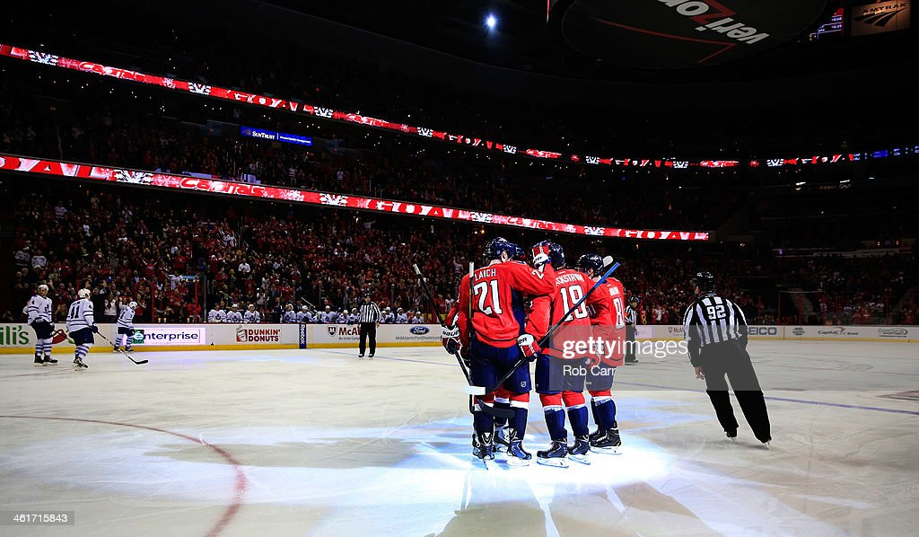 Nicklas Backstrom #19 is congratulated by teammate Brooks Laich #21 of the Washington Capitals after scoring a third period goal against the Toronto Maple Leafs during the Capitals 3-2 win at Verizon Center on January 10, 2014 in Washington, DC.