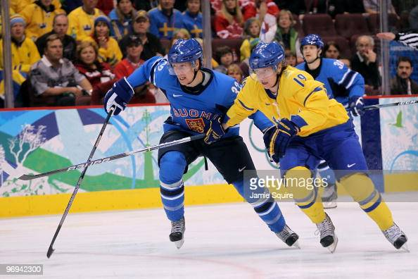 Nicklas Backstrom of Sweden fights for position against Toni Lydman of Finland during the ice hockey men's preliminary game on day 10 of the...