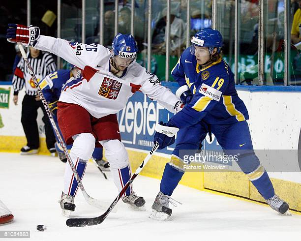 Nicklas Backstrom of Sweden passes the puck while being followed by Petr Caslava of the Czech Republic during the IIHF World Ice Hockey Championship...