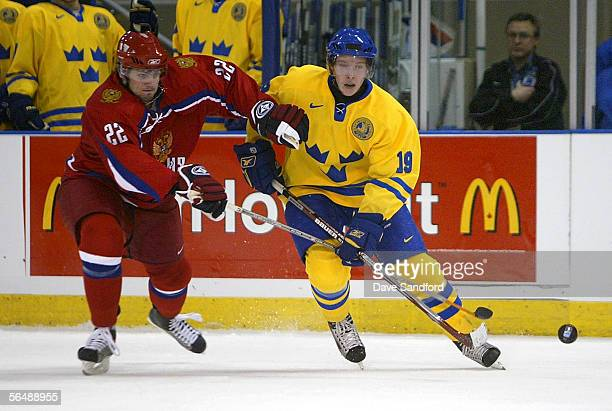 Nicklas Backstrom of Team Sweden battles for the puck with Alexander Radulov of Team Russia during their World Jr Hockey Championship game at...