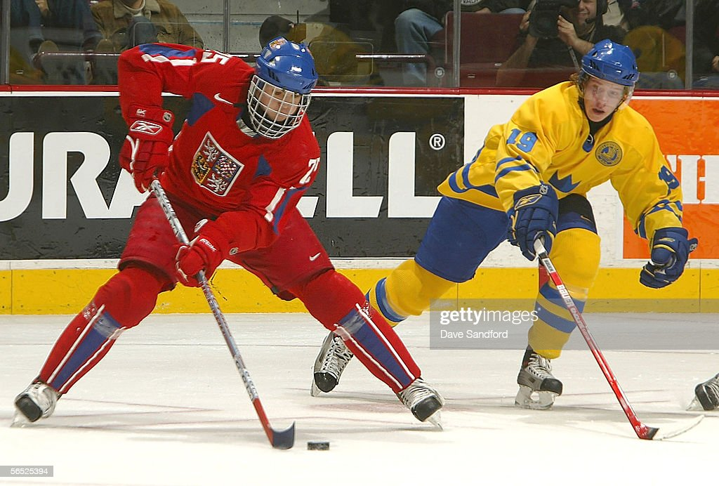 Nicklas Backstrom of Team Sweden skates after Michael Frolik of Team Czech Republic during their World Jr Hockey Championship 5th place game on...