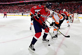 Nicklas Backstrom of the Washington Capitals and Brandon Manning of the Philadelphia Flyers battle for the puck during the first period in Game One...