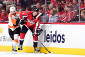 Nicklas Backstrom of the Washington Capitals and Claude Giroux of the Philadelphia Flyers battle for the puck in the third period in Game Two of the...