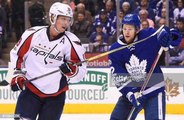 Nicklas Backstrom of the Washington Capitals and Connor Brown of the Toronto Maple Leafs compete during the third period in Game Four of the Eastern...