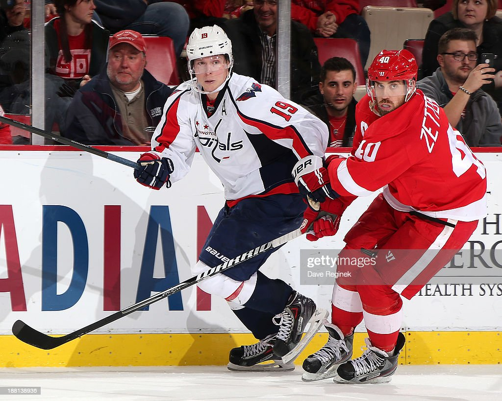 Nicklas Backstrom #19 of the Washington Capitals and <a gi-track='captionPersonalityLinkClicked' href=/galleries/search?phrase=Henrik+Zetterberg&family=editorial&specificpeople=201520 ng-click='$event.stopPropagation()'>Henrik Zetterberg</a> #40 of the Detroit Red Wings battle for position away from the puck during an NHL game at Joe Louis Arena on November 15, 2013 in Detroit, Michigan. The Capitals defeated the Wings 4-3 in a shootout.