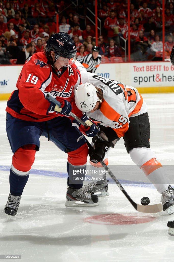 Nicklas Backstrom #19 of the Washington Capitals and <a gi-track='captionPersonalityLinkClicked' href=/galleries/search?phrase=Maxime+Talbot&family=editorial&specificpeople=2078922 ng-click='$event.stopPropagation()'>Maxime Talbot</a> #25 of the Philadelphia Flyers fight for a faceoff during the third period of an NHL hockey game at Verizon Center on February 1, 2013 in Washington, DC.