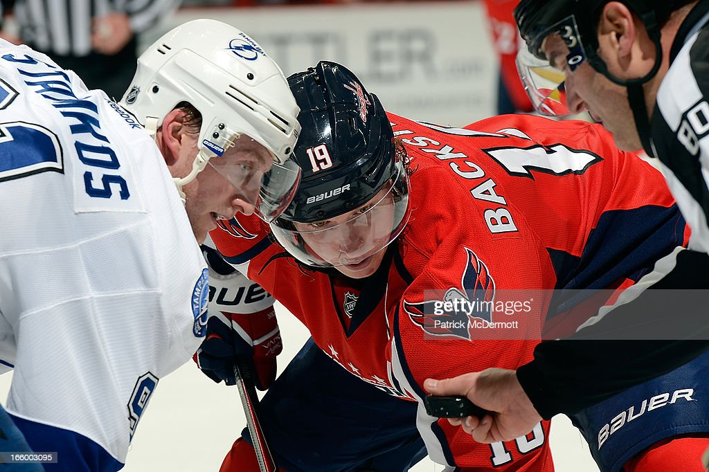 Nicklas Backstrom #19 of the Washington Capitals and <a gi-track='captionPersonalityLinkClicked' href=/galleries/search?phrase=Steven+Stamkos&family=editorial&specificpeople=4047623 ng-click='$event.stopPropagation()'>Steven Stamkos</a> #91 of the Tampa Bay Lightning wait for a faceoff during the second period of an NHL game at Verizon Center on April 7, 2013 in Washington, DC.