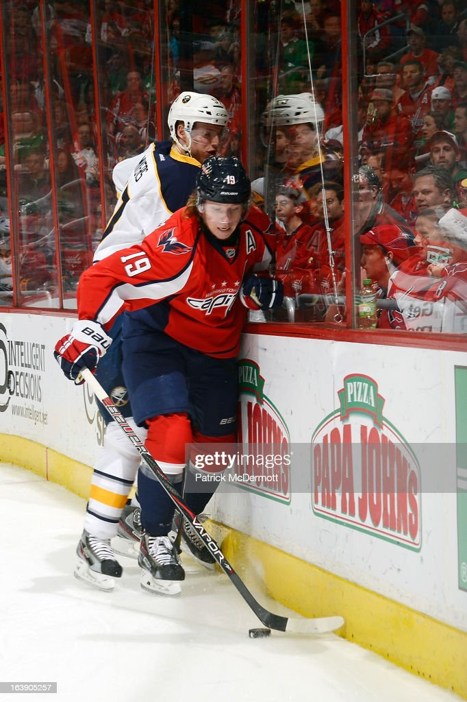 Nicklas Backstrom #19 of the Washington Capitals and <a gi-track='captionPersonalityLinkClicked' href=/galleries/search?phrase=Tyler+Myers&family=editorial&specificpeople=4595080 ng-click='$event.stopPropagation()'>Tyler Myers</a> #57 of the Buffalo Sabres battle for the puck during an NHL game at Verizon Center on March 17, 2013 in Washington, DC.