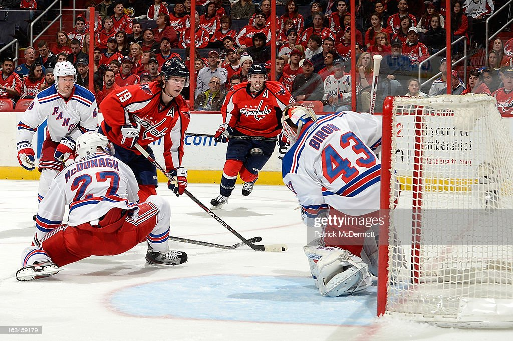 Nicklas Backstrom #19 of the Washington Capitals battles <a gi-track='captionPersonalityLinkClicked' href=/galleries/search?phrase=Ryan+McDonagh&family=editorial&specificpeople=4324983 ng-click='$event.stopPropagation()'>Ryan McDonagh</a> #27 of the New York Rangers during the third period of an NHL game between the New York Rangers and Washington Capitals at Verizon Center on March 10, 2013 in Washington, DC.