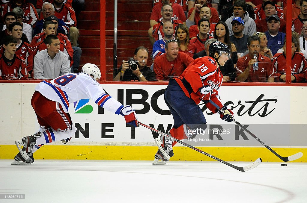 Nicklas Backstrom #19 of the Washington Capitals brings the puck up the ice against <a gi-track='captionPersonalityLinkClicked' href=/galleries/search?phrase=Marc+Staal&family=editorial&specificpeople=3809026 ng-click='$event.stopPropagation()'>Marc Staal</a> #18 of the New York Rangers in Game Four of the Eastern Conference Semifinals during the 2012 NHL Stanley Cup Playoffs at the Verizon Center on May 5, 2012 in Washington, DC.