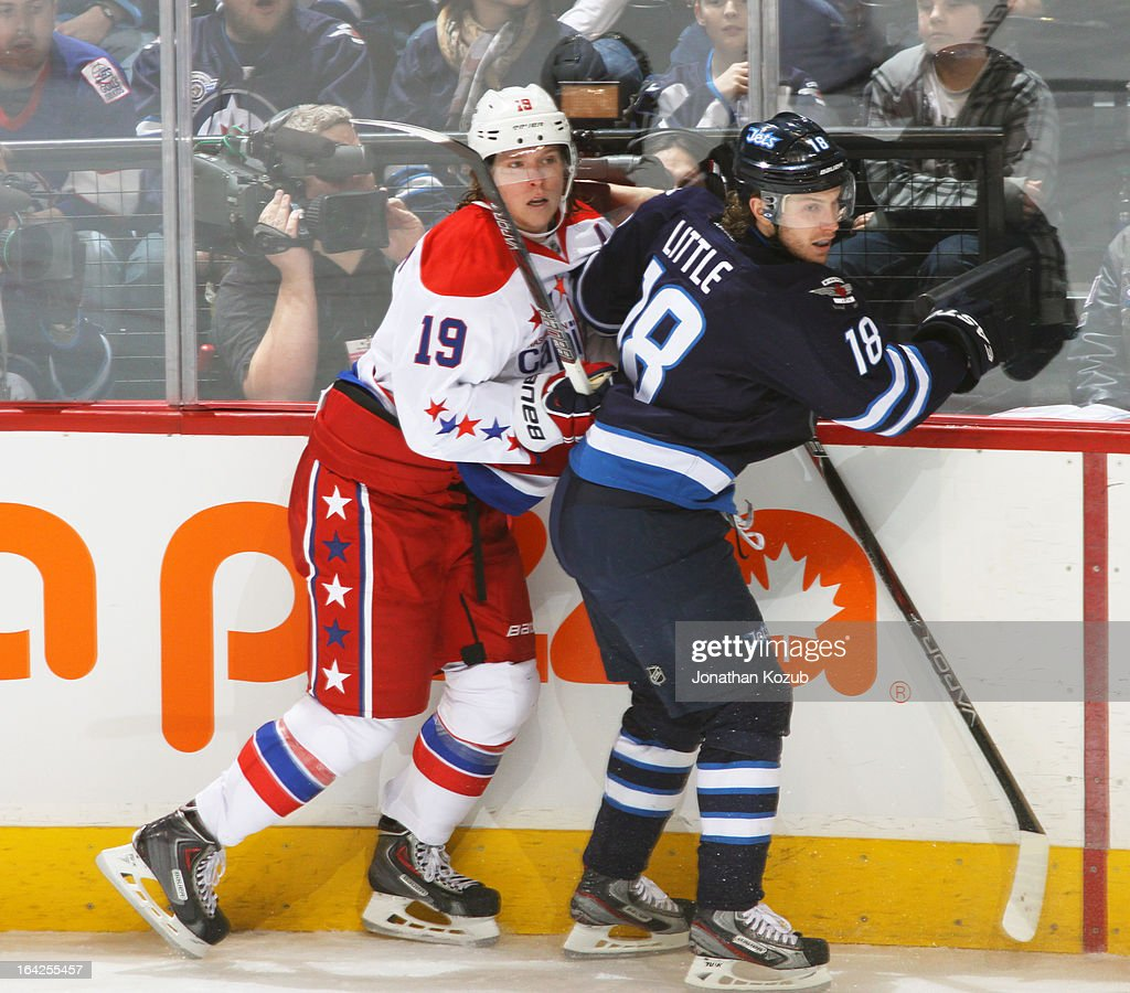 Nicklas Backstrom #19 of the Washington Capitals bumps with <a gi-track='captionPersonalityLinkClicked' href=/galleries/search?phrase=Bryan+Little&family=editorial&specificpeople=540533 ng-click='$event.stopPropagation()'>Bryan Little</a> #18 of the Winnipeg Jets along the boards during second-period action at the MTS Centre on March 21, 2013 in Winnipeg, Manitoba, Canada.