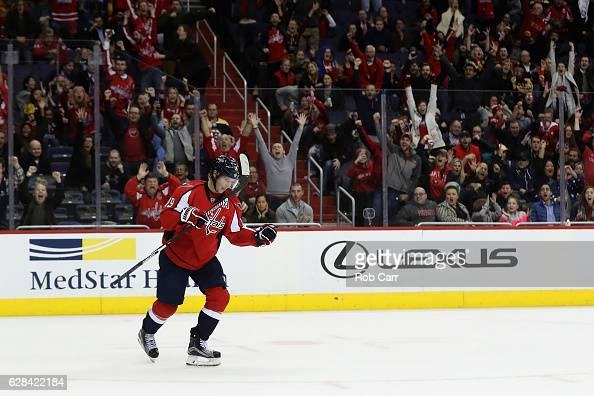 Nicklas Backstrom of the Washington Capitals celebrates after scoring the game winning goal in overtime to give the Capitals a 43 win over the Boston...