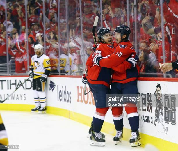 Nicklas Backstrom of the Washington Capitals celebrates his game tying goal against the Pittsburgh Penguins at 249 of the third period and is joined...