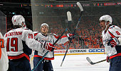 Nicklas Backstrom of the Washington Capitals celebrates his second period goal against the Philadelphia Flyers with teammates John Carlson and Alex...