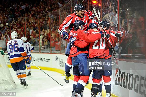 Nicklas Backstrom of the Washington Capitals celebrates with teammates after scoring in the third period against the New York Islanders during Game...