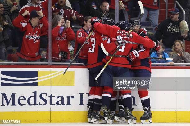 Nicklas Backstrom of the Washington Capitals celebrates with teammates after scoring a goal against the New York Rangers during the second period at...