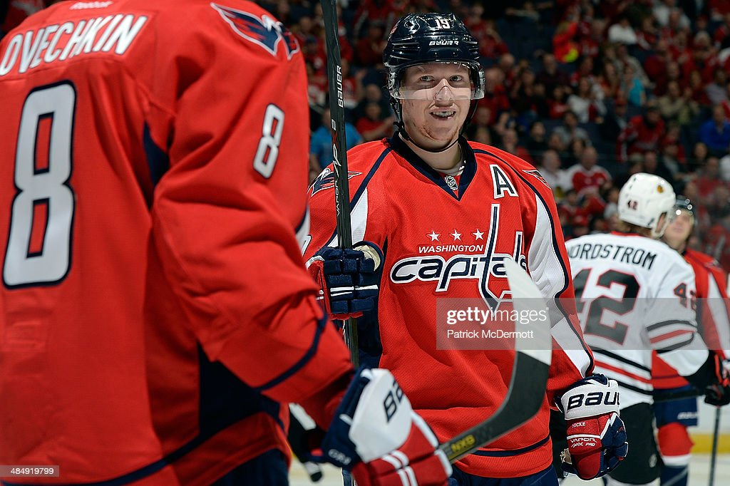Nicklas Backstrom #19 of the Washington Capitals celebrates with his teammates after scoring a goal in the second period during an NHL game against the Chicago Blackhawks at Verizon Center on April 11, 2014 in Washington, DC.