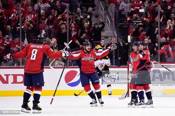 Nicklas Backstrom of the Washington Capitals celebrates with his teammates after scoring the gamewinning goal in overtime during a NHL game against...