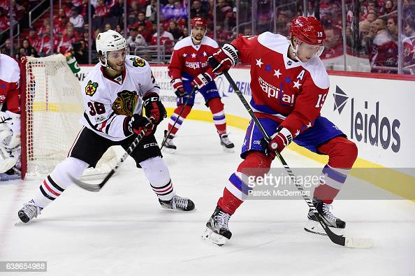 Nicklas Backstrom of the Washington Capitals controls the puck against Ryan Hartman of the Chicago Blackhawks in the second period during an NHL game...