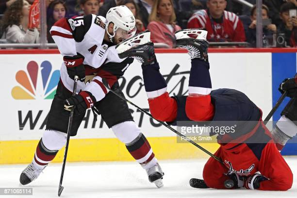 Nicklas Backstrom of the Washington Capitals crashes to the ice after colliding with Brad Richardson of the Arizona Coyotes during the third period...