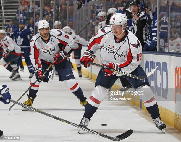 Nicklas Backstrom of the Washington Capitals drops a puck for teammate Alex Ovechkin during action against the Toronto Maple Leafs in Game Six of the...