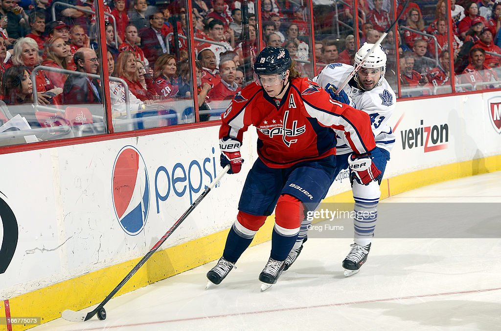 Nicklas Backstrom #19 of the Washington Capitals handles the puck against <a gi-track='captionPersonalityLinkClicked' href=/galleries/search?phrase=Nazem+Kadri&family=editorial&specificpeople=4043234 ng-click='$event.stopPropagation()'>Nazem Kadri</a> #43 of the Toronto Maple Leafs at the Verizon Center on April 16, 2013 in Washington, DC.