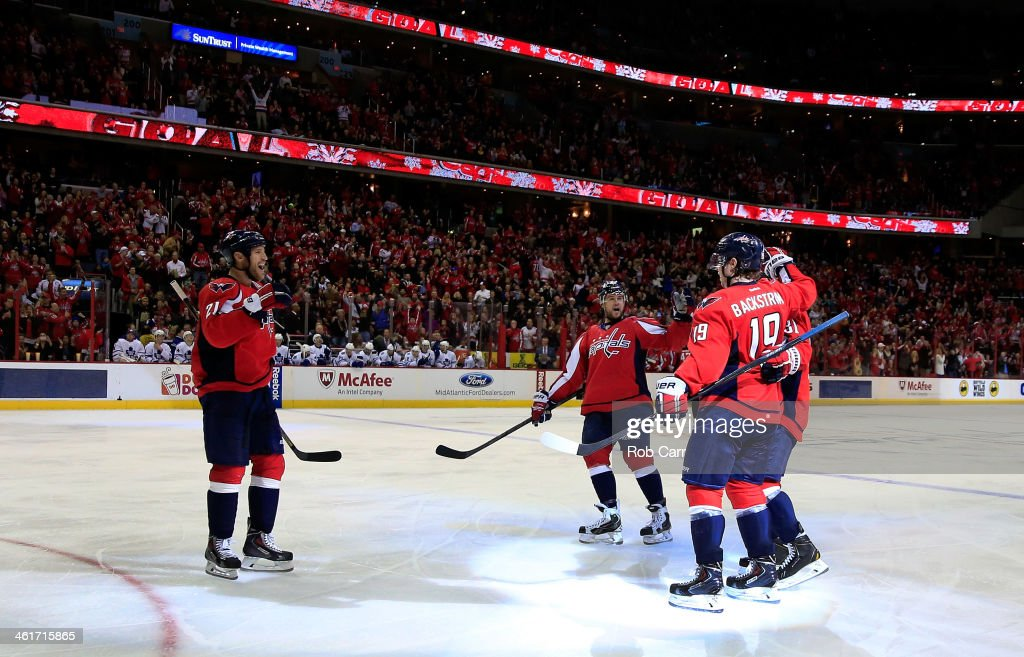 Nicklas Backstrom #19 of the Washington Capitals is congratulated by teammates after scoring a third period goal against the Toronto Maple Leafs during the Capitals 3-2 win at Verizon Center on January 10, 2014 in Washington, DC.