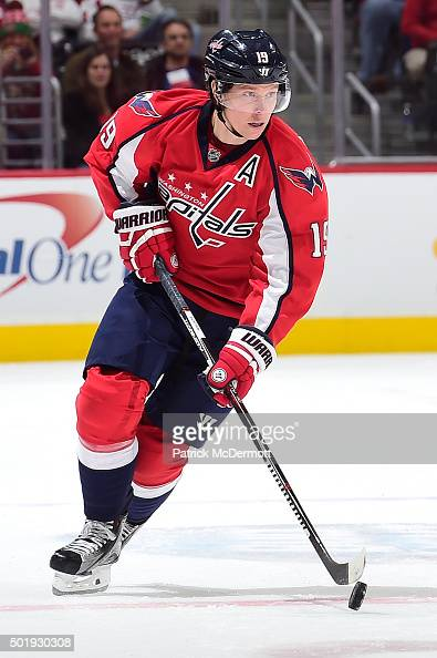Nicklas Backstrom of the Washington Capitals moves the puck up ice against the Tampa Bay Lightning in the third period during an NHL game at Verizon...