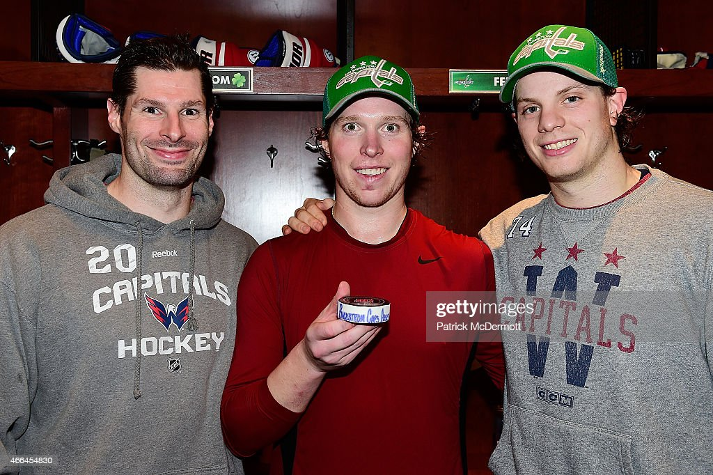 Nicklas Backstrom #19 of the Washington Capitals poses for a photo with teammates <a gi-track='captionPersonalityLinkClicked' href=/galleries/search?phrase=Troy+Brouwer&family=editorial&specificpeople=4155305 ng-click='$event.stopPropagation()'>Troy Brouwer</a> #20 and <a gi-track='captionPersonalityLinkClicked' href=/galleries/search?phrase=John+Carlson+-+Ice+Hockey+Player&family=editorial&specificpeople=7983228 ng-click='$event.stopPropagation()'>John Carlson</a> #74 after becoming the franchise assists leader during an NHL game against the Boston Bruins at Verizon Center on March 15, 2015 in Washington, DC. Backstrom got his 419th assist on a goal by <a gi-track='captionPersonalityLinkClicked' href=/galleries/search?phrase=John+Carlson+-+Ice+Hockey+Player&family=editorial&specificpeople=7983228 ng-click='$event.stopPropagation()'>John Carlson</a> in the first period.