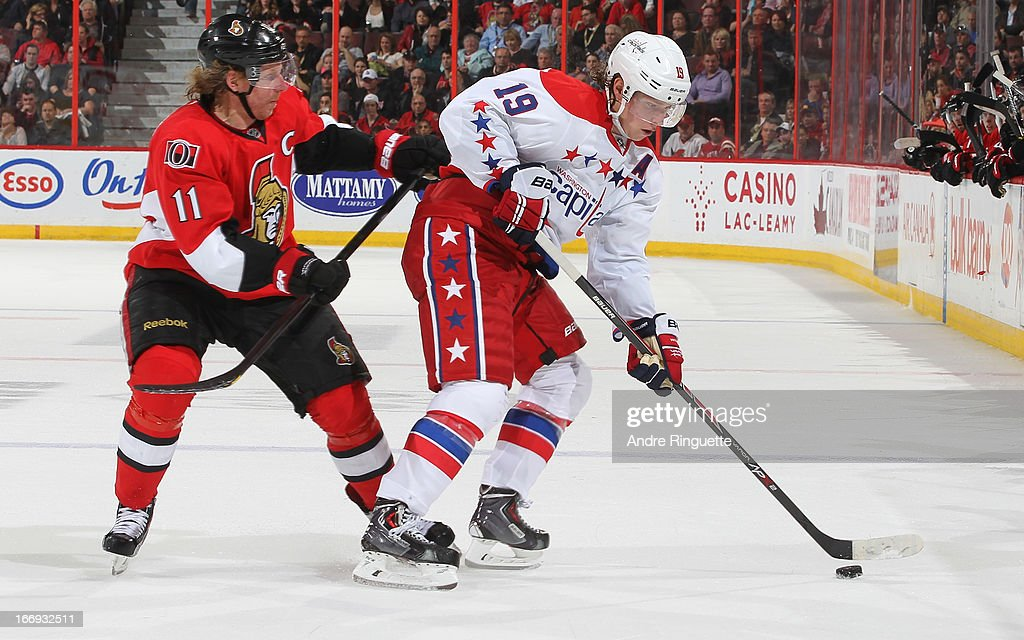Nicklas Backstrom #19 of the Washington Capitals protects the puck from <a gi-track='captionPersonalityLinkClicked' href=/galleries/search?phrase=Daniel+Alfredsson&family=editorial&specificpeople=201853 ng-click='$event.stopPropagation()'>Daniel Alfredsson</a> #11 of the Ottawa Senators on April 18, 2013 at Scotiabank Place in Ottawa, Ontario, Canada.