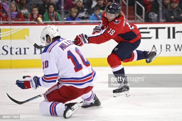 Nicklas Backstrom of the Washington Capitals scores a goal against the New York Rangers during the second period at Capital One Arena on December 08...
