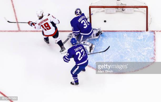 Nicklas Backstrom of the Washington Capitals scores a goal on Frederik Andersen and Nikita Zaitsev of the Toronto Maple Leafs during the first period...