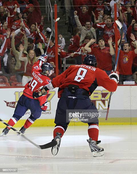 Nicklas Backstrom of the Washington Capitals scores his third goal of the game in overtime and is joined Alex Ovechkin as they defeat the Montreal...