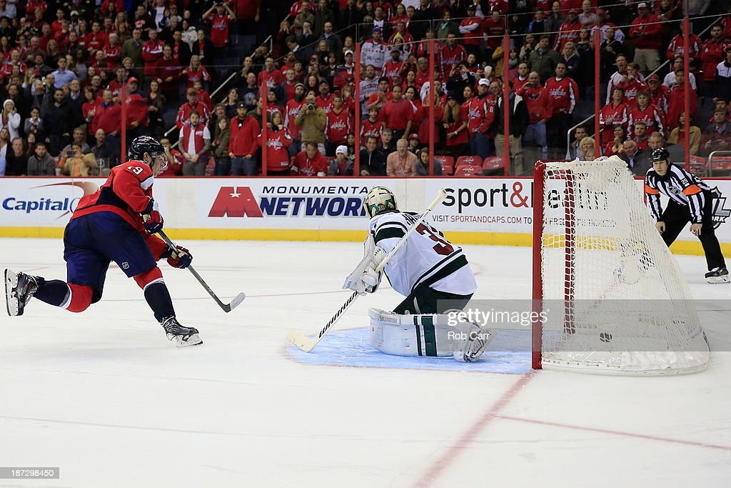 Nicklas Backstrom #19 of the Washington Capitals scores the game winning goal against goalie <a gi-track='captionPersonalityLinkClicked' href=/galleries/search?phrase=Josh+Harding&family=editorial&specificpeople=700587 ng-click='$event.stopPropagation()'>Josh Harding</a> #37 of the Minnesota Wild during the Capitals 3-2 win in a shootout at Verizon Center on November 7, 2013 in Washington, DC.