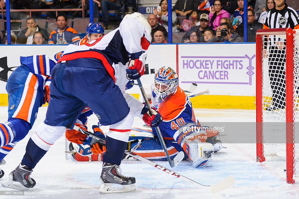 Nicklas Backstrom #19 of the Washington Capitals shoots the puck past Devan Dubnyk #40 of the Edmonton Oilers during an NHL game at Rexall Place on October 24, 2013 in Edmonton, Alberta, Canada.