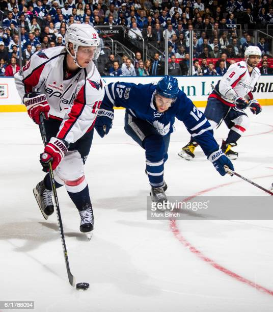 Nicklas Backstrom of the Washington Capitals skates against Connor Brown of the Toronto Maple Leafs during the third period in Game Four of the...