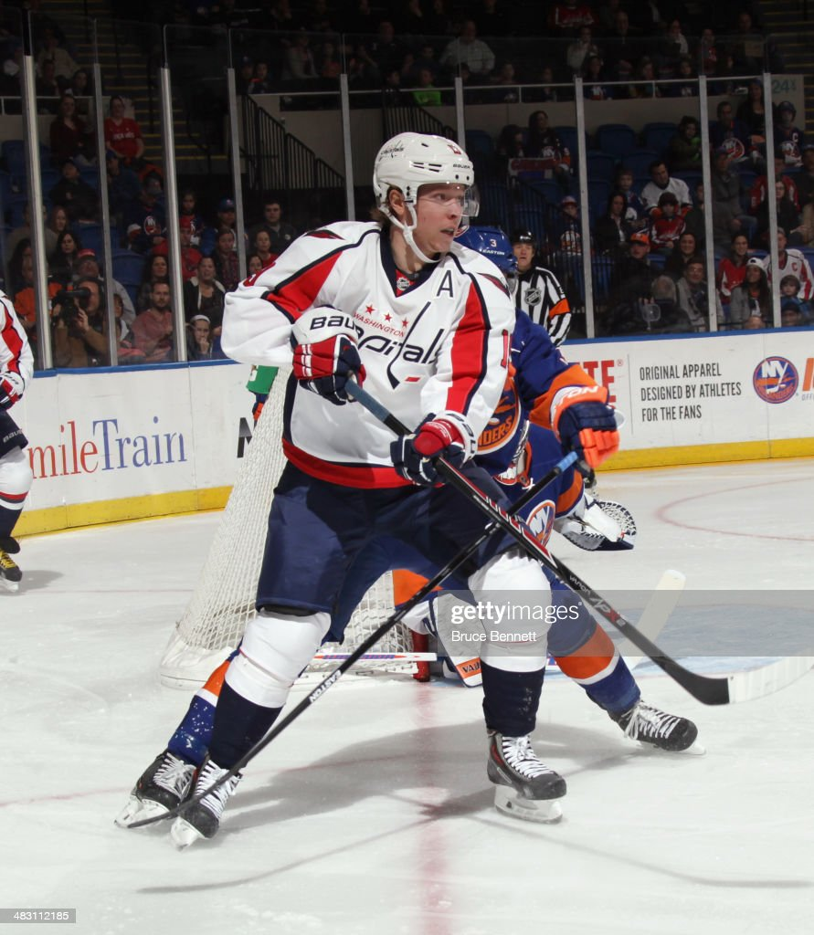 Nicklas Backstrom #19 of the Washington Capitals skates against the New York Islanders at the Nassau Veterans Memorial Coliseum on April 5, 2014 in Uniondale, New York. The Capitals defeated the Islanders 4-3 in the shootout.
