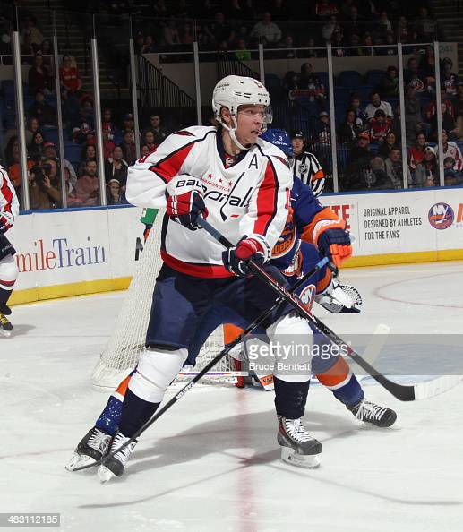 Nicklas Backstrom of the Washington Capitals skates against the New York Islanders at the Nassau Veterans Memorial Coliseum on April 5 2014 in...