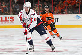 Nicklas Backstrom of the Washington Capitals skates in front of Andrew MacDonald of the Philadelphia Flyers during the second period at Wells Fargo...