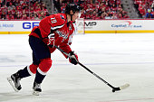 Nicklas Backstrom of the Washington Capitals skates with the puck against the Philadelphia Flyers during the third period in Game One of the Eastern...