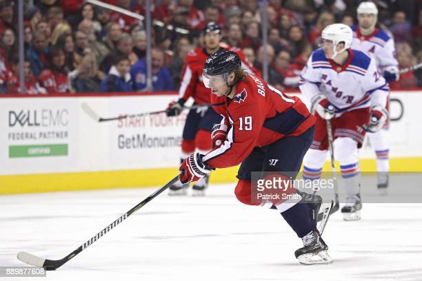 Nicklas Backstrom of the Washington Capitals skates with the puck against the New York Rangers during the second period at Capital One Arena on...