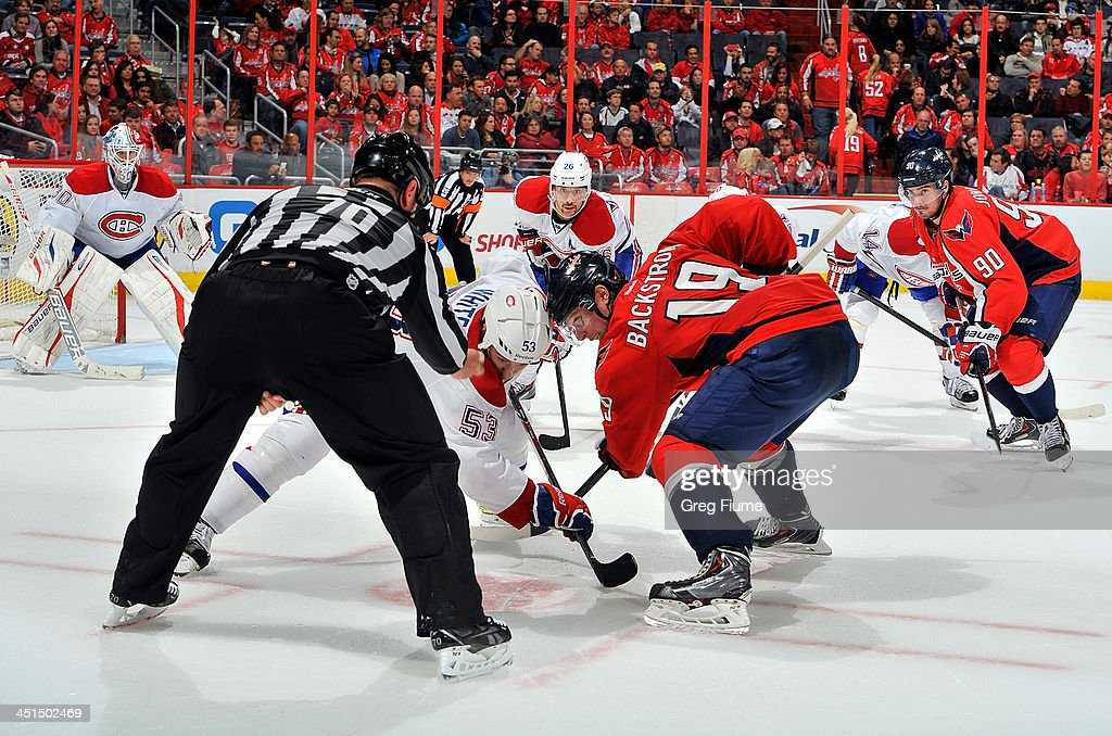 Nicklas Backstrom #19 of the Washington Capitals takes a face-off in the third period against <a gi-track='captionPersonalityLinkClicked' href=/galleries/search?phrase=Ryan+White+-+Ice+Hockey+Player&family=editorial&specificpeople=16069622 ng-click='$event.stopPropagation()'>Ryan White</a> #53 of the Montreal Canadiens at the Verizon Center on November 22, 2013 in Washington, DC.