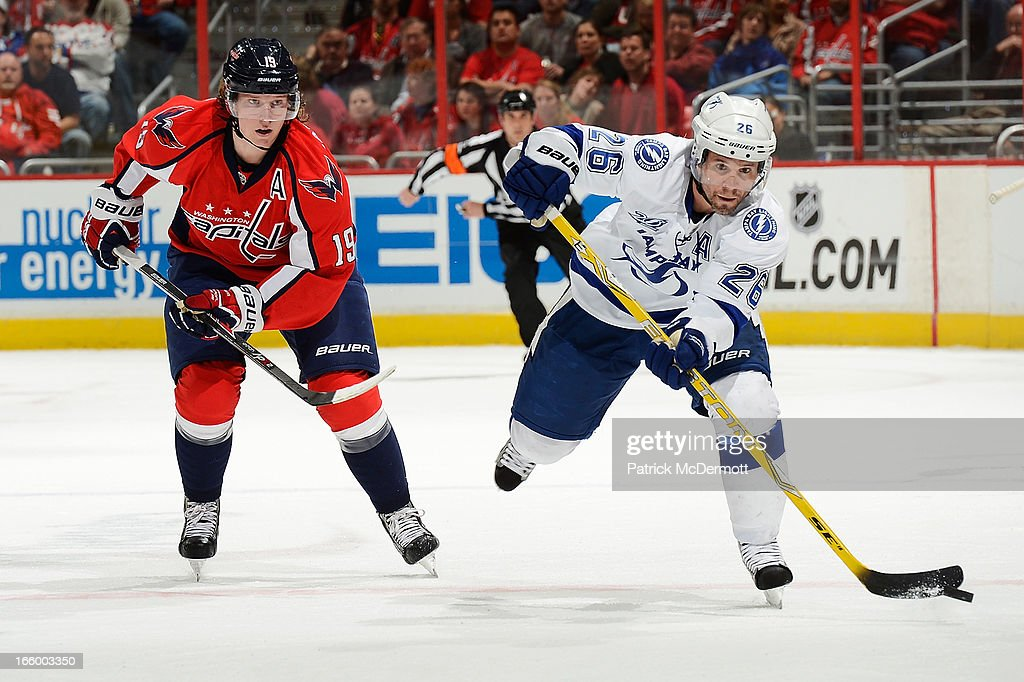 Nicklas Backstrom #19 of the Washington Capitals watches <a gi-track='captionPersonalityLinkClicked' href=/galleries/search?phrase=Martin+St.+Louis&family=editorial&specificpeople=202067 ng-click='$event.stopPropagation()'>Martin St. Louis</a> #26 of the Tampa Bay Lightning advance the puck up ice during an NHL game at Verizon Center on April 7, 2013 in Washington, DC.