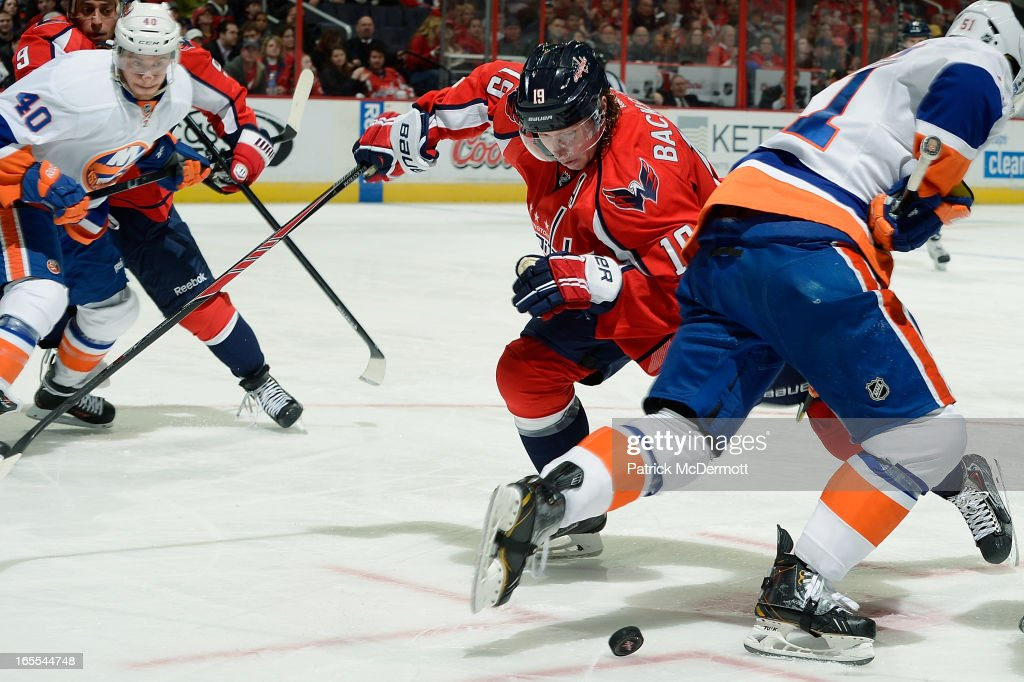 Nicklas Backstrom #19 of the Washington Capitals wins a faceoff against <a gi-track='captionPersonalityLinkClicked' href=/galleries/search?phrase=Frans+Nielsen&family=editorial&specificpeople=634894 ng-click='$event.stopPropagation()'>Frans Nielsen</a> #51 of the New York Islanders in the second period of an NHL game at Verizon Center on April 4, 2013 in Washington, DC.
