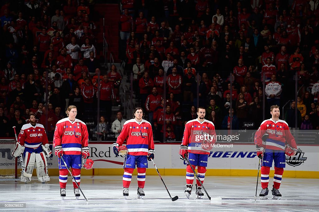 Nicklas Backstrom #19, <a gi-track='captionPersonalityLinkClicked' href=/galleries/search?phrase=T.J.+Oshie&family=editorial&specificpeople=700383 ng-click='$event.stopPropagation()'>T.J. Oshie</a> #77, <a gi-track='captionPersonalityLinkClicked' href=/galleries/search?phrase=Matt+Niskanen&family=editorial&specificpeople=2106633 ng-click='$event.stopPropagation()'>Matt Niskanen</a> #2, and <a gi-track='captionPersonalityLinkClicked' href=/galleries/search?phrase=Karl+Alzner&family=editorial&specificpeople=3938829 ng-click='$event.stopPropagation()'>Karl Alzner</a> #27 of the Washington Capitals listen to the National Anthem before their game against the Philadelphia Flyers at Verizon Center on February 7, 2016 in Washington, DC.