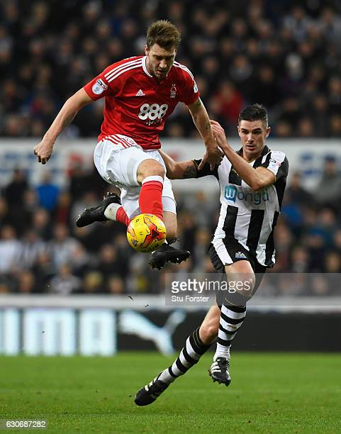 Nicklas Bendtner challenges Ciaran Clark during the Sky Bet Championship match between Newcastle United and Nottingham Forest at St James' Park on...